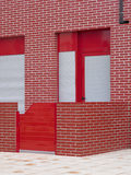 Red building facade with patio. Stock Photos
