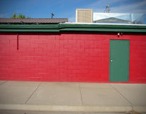 Red building with green door Royalty Free Stock Images