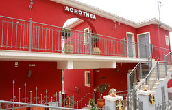 Red building of hotel in Parga town. Royalty Free Stock Photography