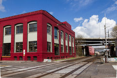 Red Building Railroad Tracks. Brick building alongside railroad tracks in east Portland Royalty Free Stock Image