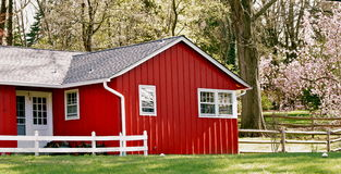 Red House. A Red building sits alone  in the  woods Stock Photo