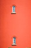Red building with two small windows Stock Photography
