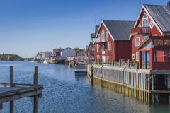 Red buildings near water Stock Images