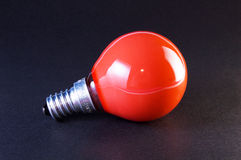 Red bulb on black background Royalty Free Stock Image