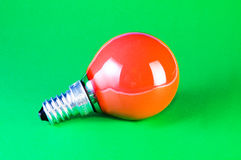 Red bulb on green background Royalty Free Stock Photo