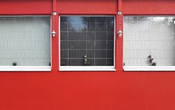 Red bulding with square windows exterior stock photo