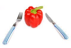 Red bulgarian pepper knife and fork Royalty Free Stock Photo