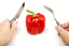 Red bulgarian pepper knife and fork Stock Image