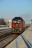 Red Bulgarian railways diesel locomotive pulls into Plovdiv station Bulgaria Royalty Free Stock Photography