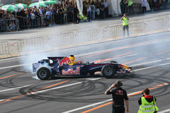 Red Bull dat de doorsmelting van de Raceauto rent Stock Foto