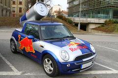 Red Bull mini cooper publicity car. With a can of red bull drink behind. Used for promotion at Red bull events Stock Photography