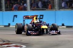 Red Bull que compite con a las personas en Singapur F1 Imagenes de archivo