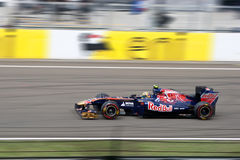 Red Bull Racing. Image of a Scuderia Torro Rosso F1 car driving on the straight line of the Hungaroring racetrack near Budapest. The image was taken at the Stock Photos