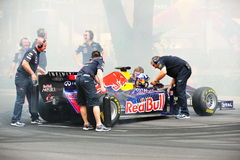 Red Bull Racing pit crews cooling F1 car Royalty Free Stock Image
