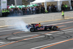 Red Bull Racing Race Car. Neel Jani on Formula 1 demonstration during motorway opening near Zurich, Tunnel-Crossing, burn-out Royalty Free Stock Photo