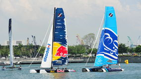 Red Bull Sailing Team racing The Wave Muscat at Extreme Sailing Series Singapore 2013 Royalty Free Stock Photo