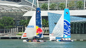 Red Bull Sailing team racing the Wave, Muscat at Extreme Sailing Series Singapore 2013 Royalty Free Stock Photos
