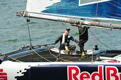 Red Bull Sailing Team skipper steering boat at Extreme Sailing Series Singapore 2013 Stock Images