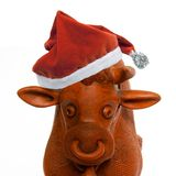 Red bull in santa hat Royalty Free Stock Photography