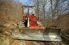 Red bulldozer in forest Stock Images