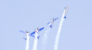 Red Bulls performing aerobatics at Aero India Show 2013. Royalty Free Stock Photos