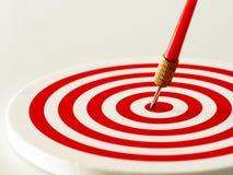 Red bullseye dart arrow hitting target center of dartboard. Concept of success, target, goal, achievement. Selective focus Stock Photos