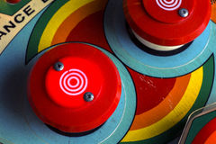 Red bumpers on a retro pinball machine. Overhead view of red ball bumpers on a pinball machine Royalty Free Stock Photos