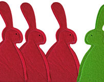 Red bunnies meet green one Royalty Free Stock Photos