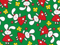 Red bunnies and yellow daisies Royalty Free Stock Image