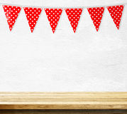 Red bunting party flag with heart shape pattern hanging over emp Royalty Free Stock Photography