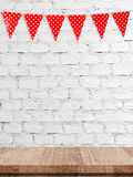 Red bunting party flag with heart shape pattern hanging over emp Royalty Free Stock Images