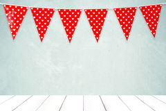 Red bunting party flag with heart shape pattern hanging over gre Stock Photography