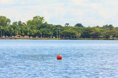 Red buoy on big lake Stock Images