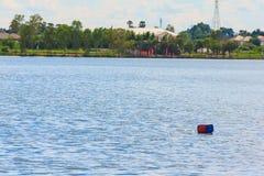 Red buoy on big lake Stock Image