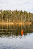 Red buoy on the lake. Stock Images