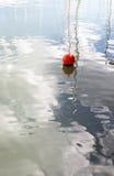 Red buoy in marina Stock Photography