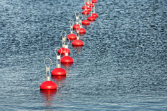Red buoy for mooring boats on the water Royalty Free Stock Photos