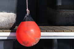 Red buoy for protecting moored yachts Stock Photography