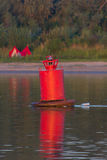 Red buoy in river Royalty Free Stock Photography