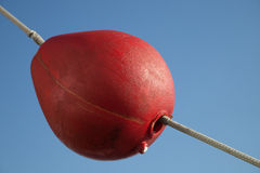Red buoy on the rope Stock Photography