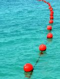 Red buoy row Royalty Free Stock Photos