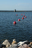 Red buoy in sea Stock Image