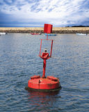 Red buoy in the sea. Red buoy in the blue sea Royalty Free Stock Photography