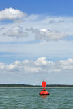 Red buoy at the sea Royalty Free Stock Image