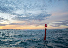 Red Buoy at Sunset Stock Photography