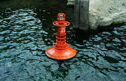 The Red buoy on water Stock Photos