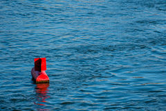 Red buoy water surface Stock Photography