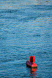 Red buoy water surface Royalty Free Stock Images