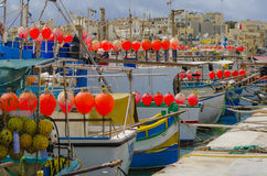 Red buoys fishing boats Stock Photo