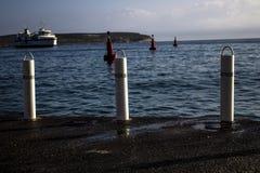 The red buoys. Three red buoys marking port area Royalty Free Stock Photo